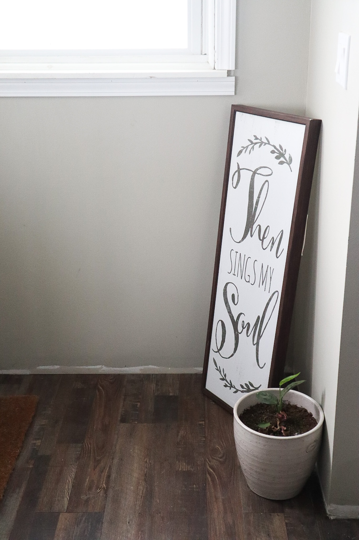Sign in the corner of the wall that brings the feeling to the home when you walk in.