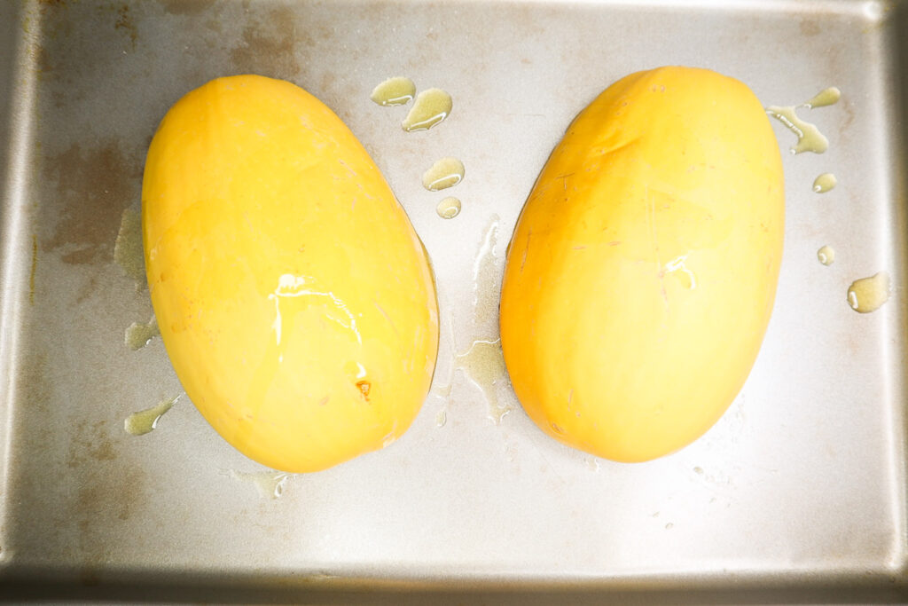 squash flipped over on a pan