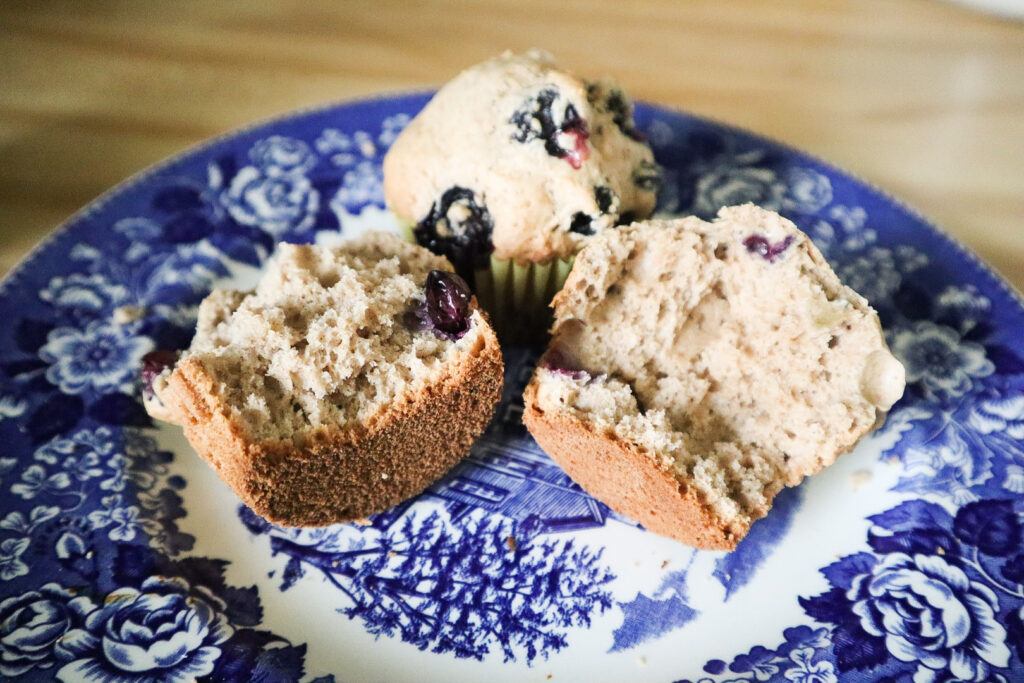 Sourdough Cinnamon Blueberry Muffins on a plate