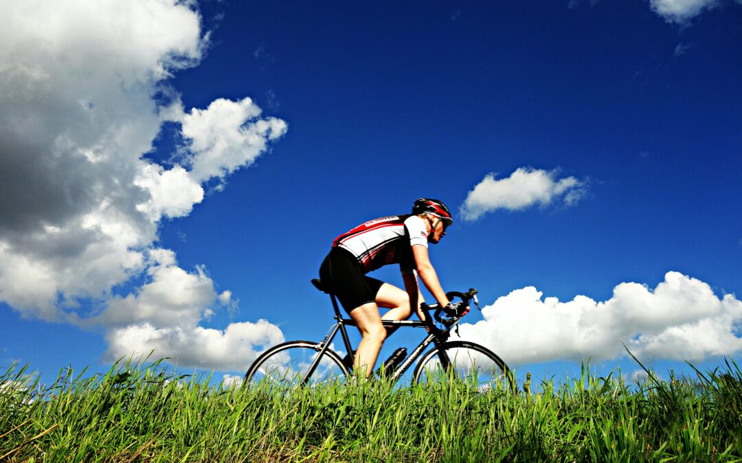 Bicycle rider riding through a field