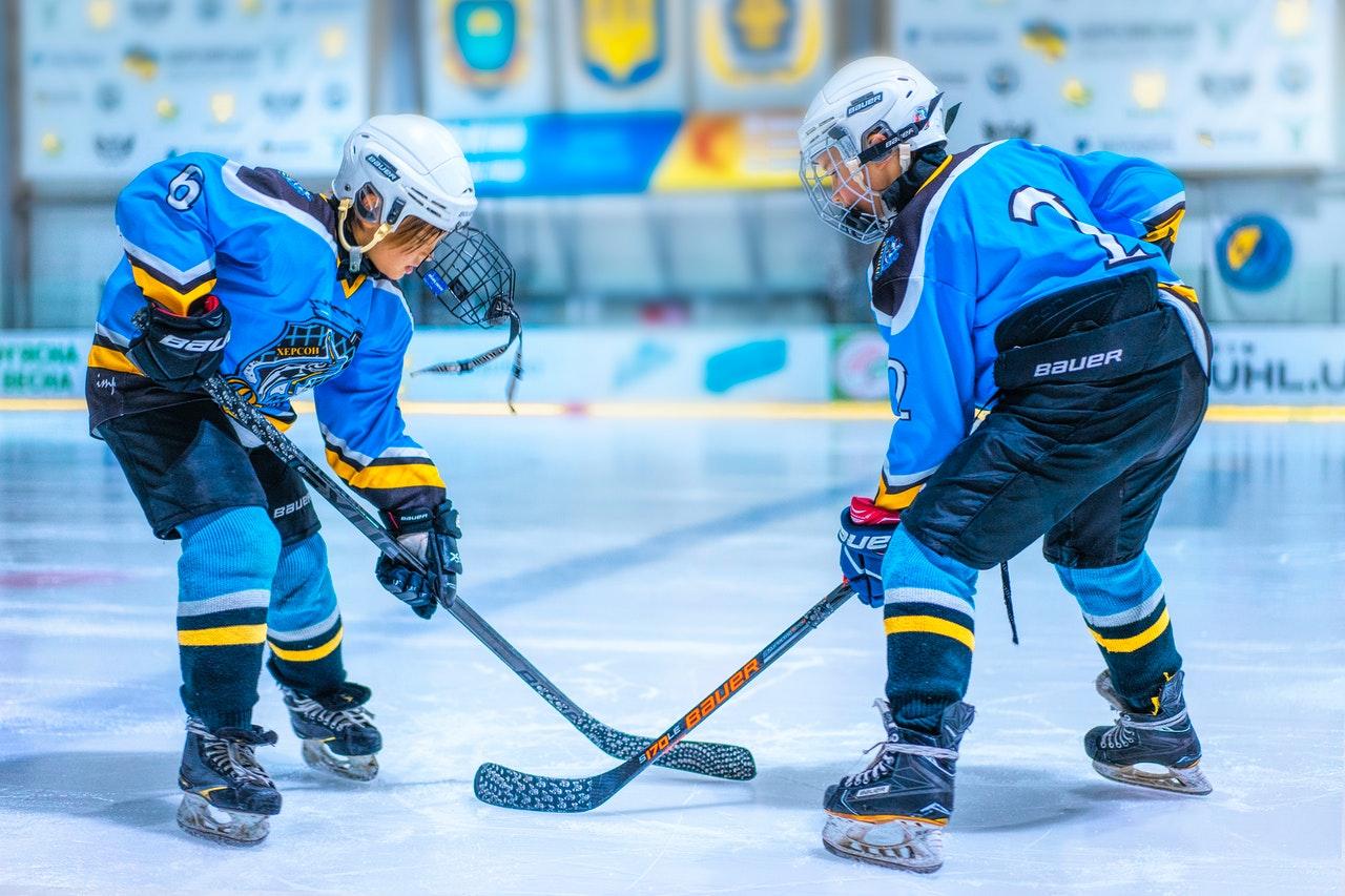 Children playing hockey.