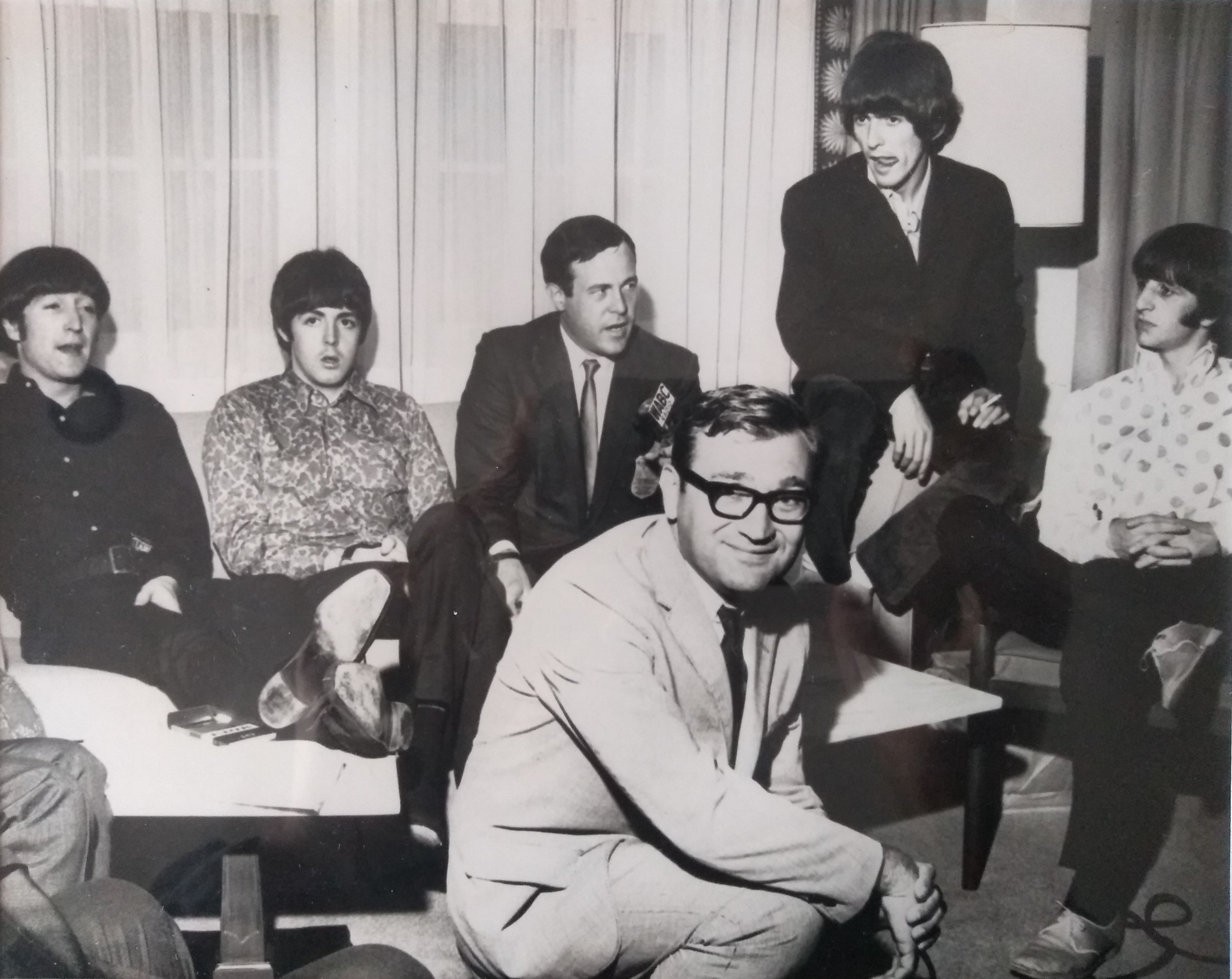 "Rick Sklar and Bruce ""Cousin Brucie"" Morrow welcome John, Paul, George and Ringo to New York in 1964."