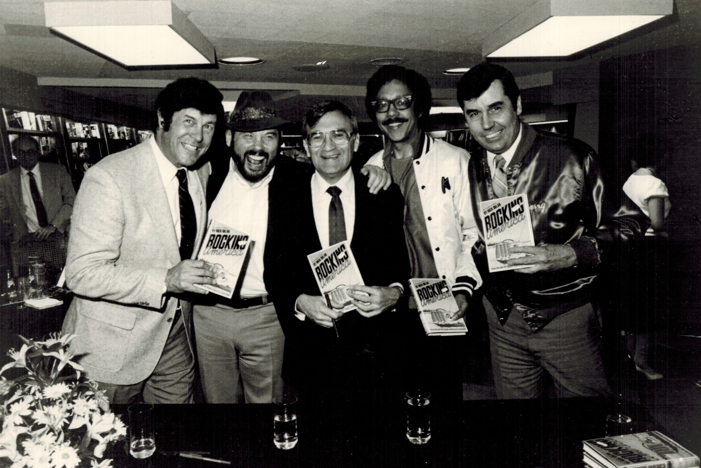 WABC disc jockeys at the Rocking America book launch party in 1984. (Left to right: Bruce Morrow, Ron Lundy, Rick Sklar, Chuck Leonard and Harry Harrison.)