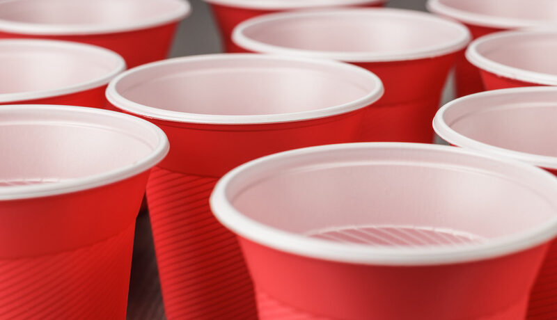 BIO PLASTIC red plastic cups on the table