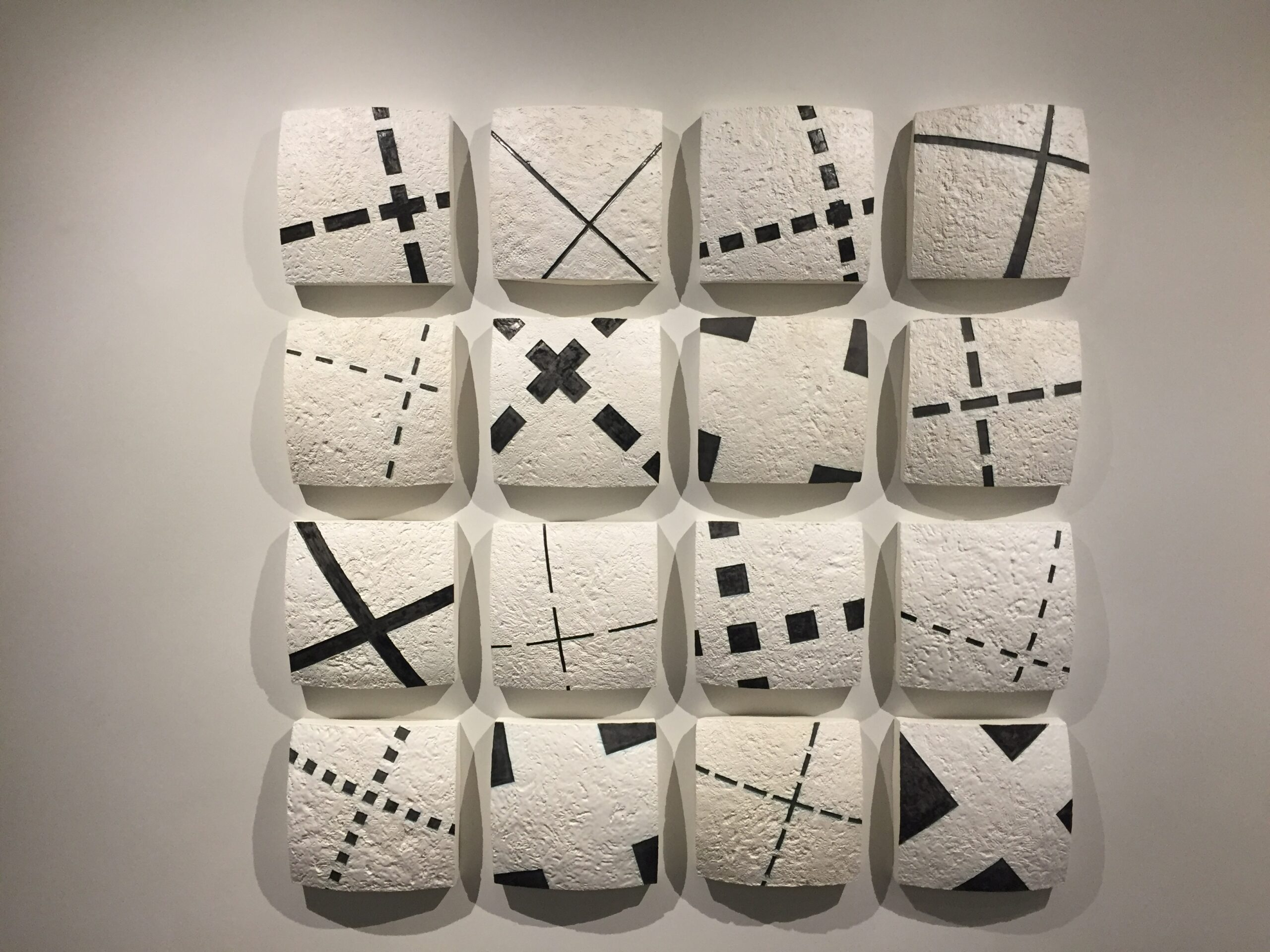 Group of 16 series X ceramic tablets by Gregor Turk