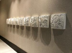 row of 9 ceramic TopoTablets installed in Miami