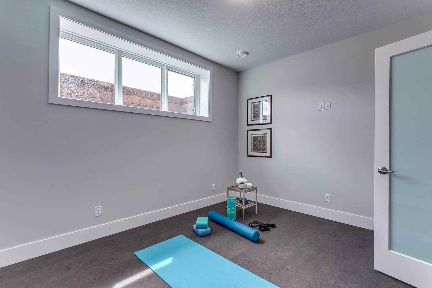 Watermark at Bearspaw basement workout room residential design