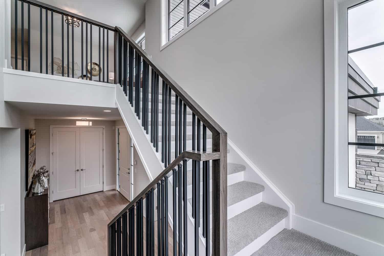 Watermark at Bearspaw staircase custom home