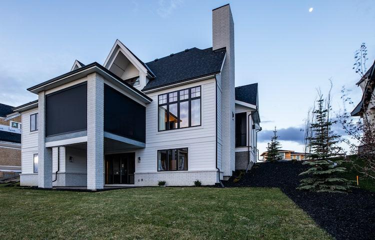 Watermark at Bearspaw - Modern Farmhouse back exterior
