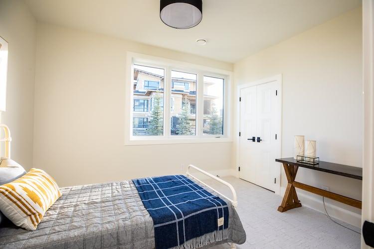 Watermark at Bearspaw – Modern Farmhouse bedroom
