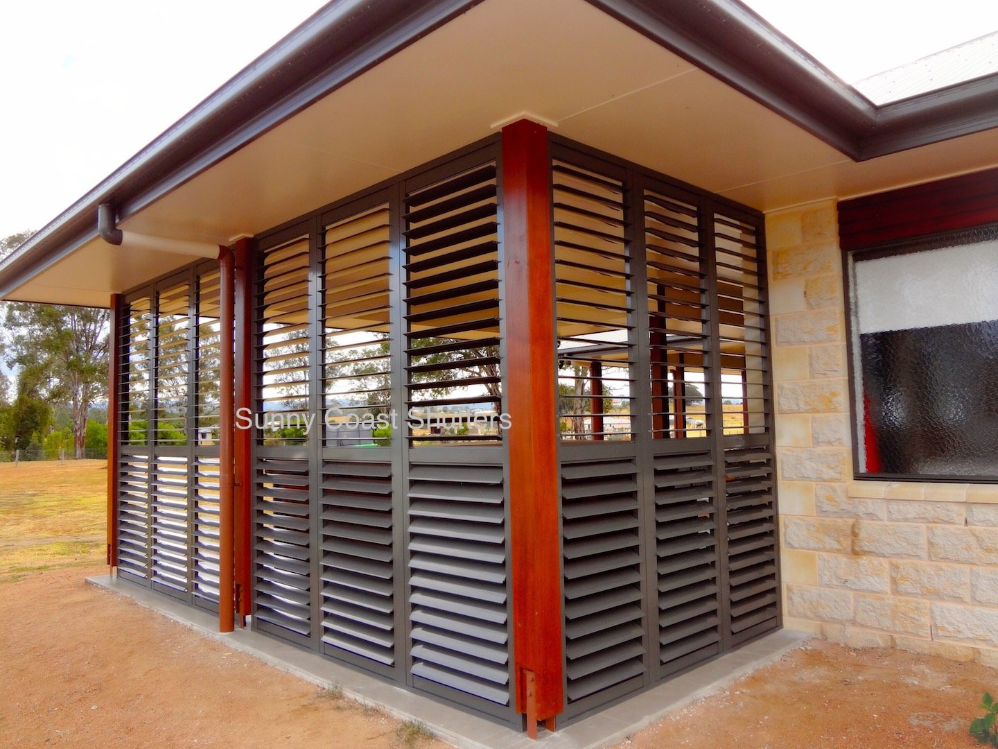 Exterior plantation shutter Monument colour bond
