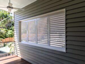 white plantation shutter outdoors