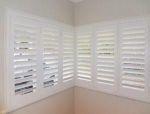 White corner shutters hinged
