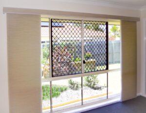 Panel glide blind with pelmet light filter