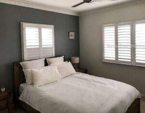 white hinged shutters in bedroom