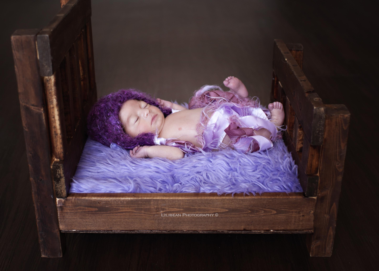 southfloridanewbornphotographer purple lavendar miami photographer baby bed wood bed
