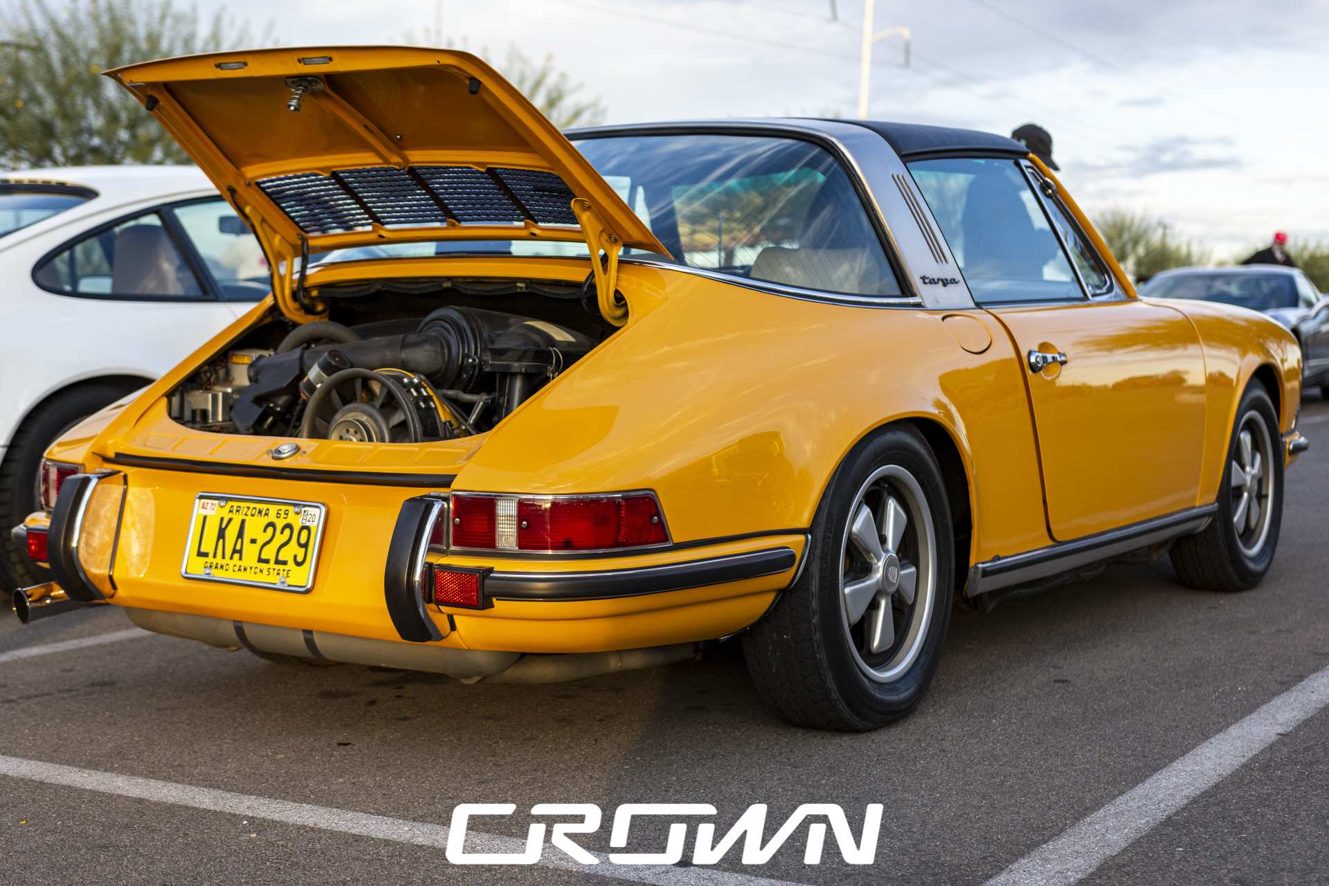 1972 Porsche 911 T Targa in yellow at cars and coffee tucson Arizona
