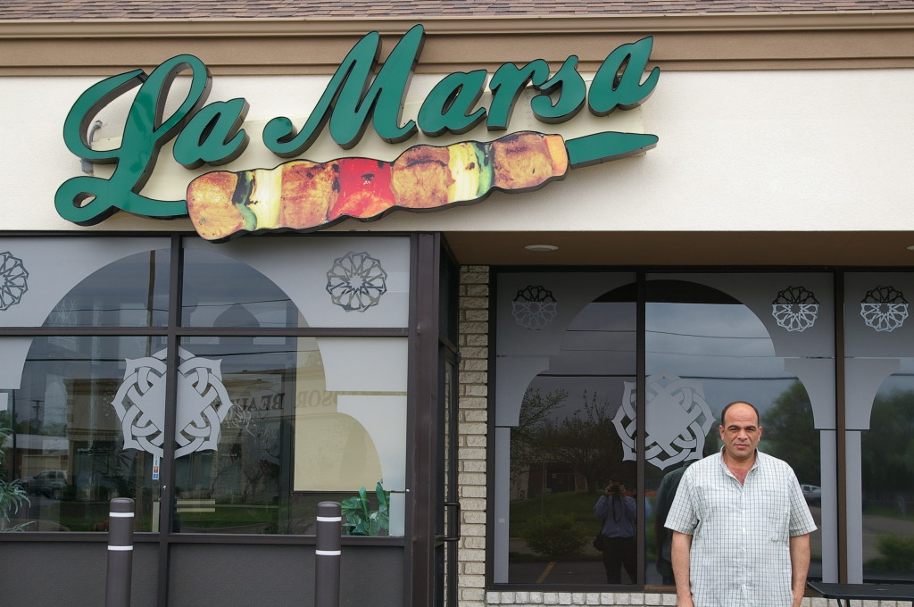 Mr. Ahmed, in front of one of his West Bloomfield locations.
