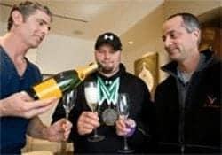 Steven Holcomb celebrating winning gold medal