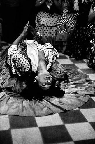 La Golondrina doing a floor backbend in Granada, Spain, in 1954. © The Inge Morath Foundation/Magnum Photos