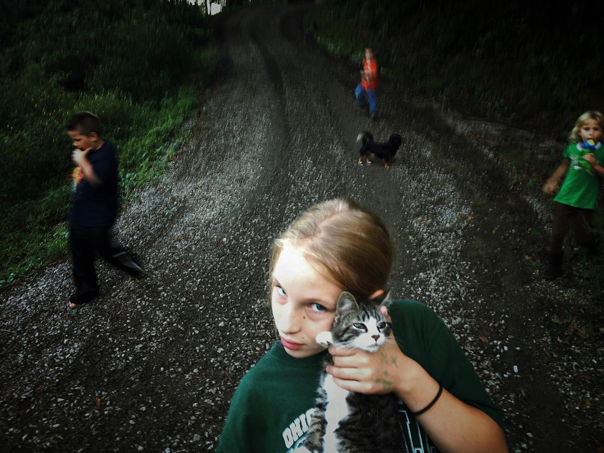 Sonya holds her neighbor's cat © Maddie McGarvey, 2014