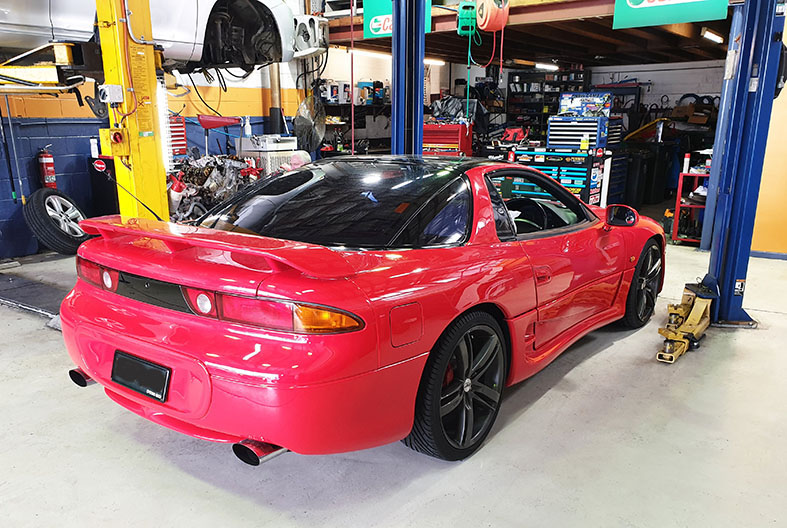 A red GTO in the workshop