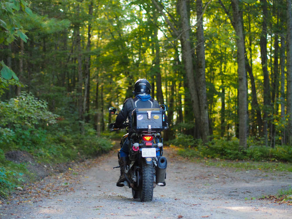 v strom 1000 riding down gravel road at Black Donald Tent and Trailer park near calabogie ontario. Riders welcome.