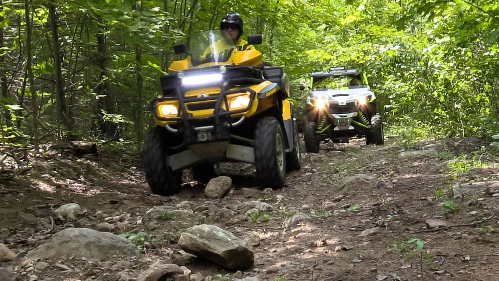 ATV's riding on a trail near campground