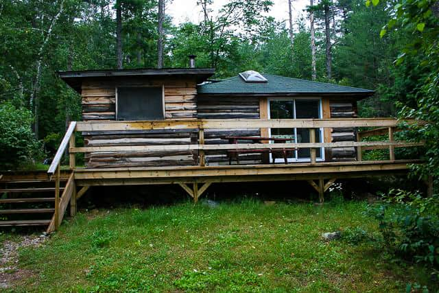 large log cabin for rent on Norcan Lake with big front deck