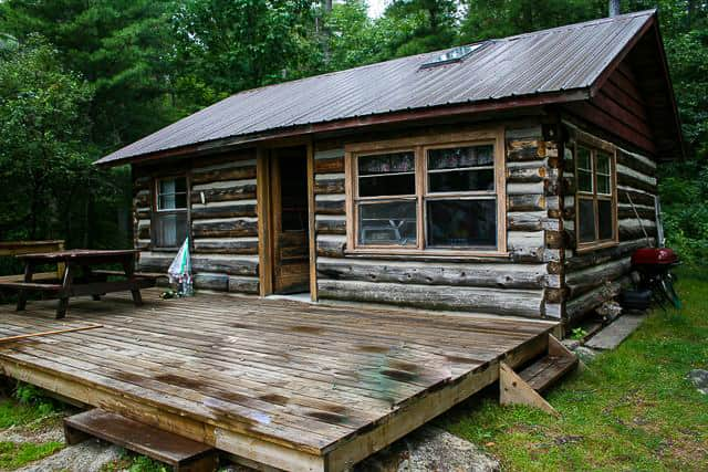 Log cabin on Norcan Lake with decking in front