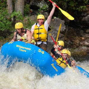 Rafting down the rapids on the Ottawa River in a Wilderness Tours raft