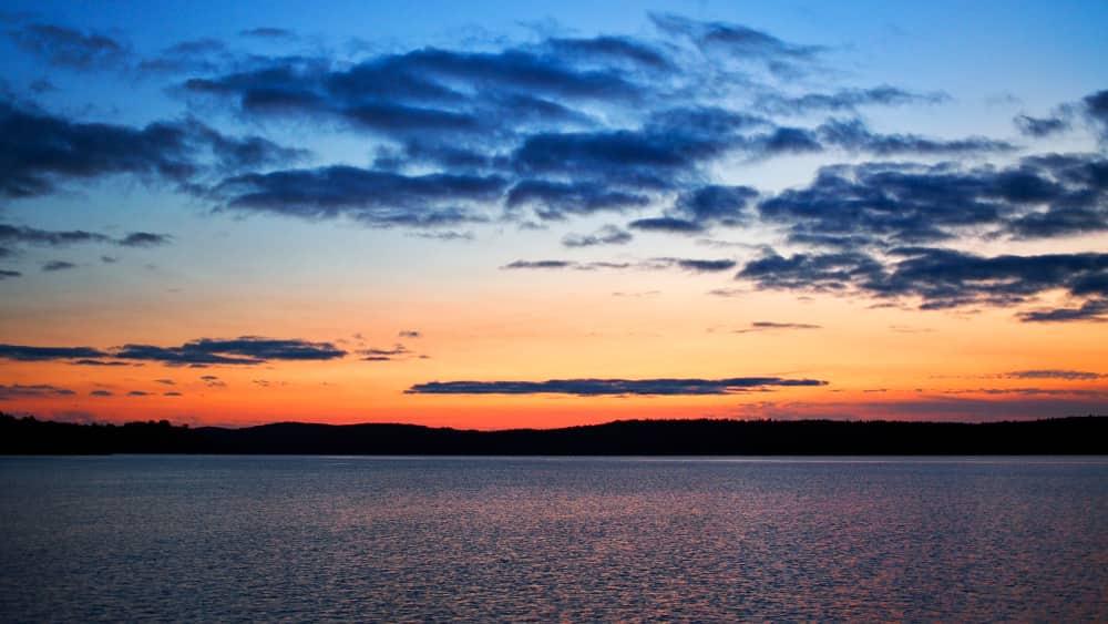 orange and blue sky at sunset over Black Donald Centennial Lake