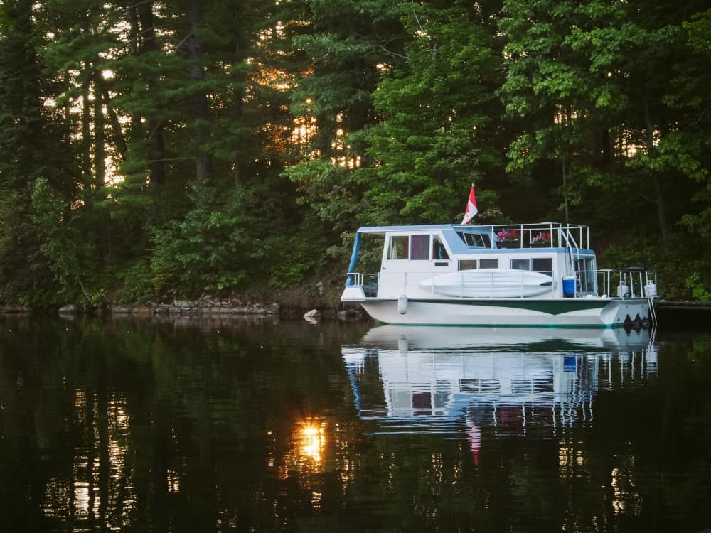 A houseboat at dock at sunset