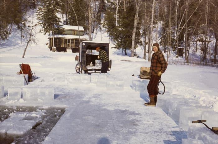 two men cutting ice blocks on the madawaska river