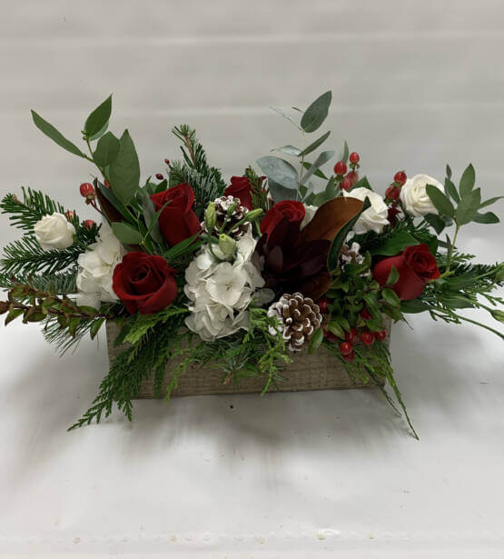A picture of a red, white and green rectangular Christmas arrangement.