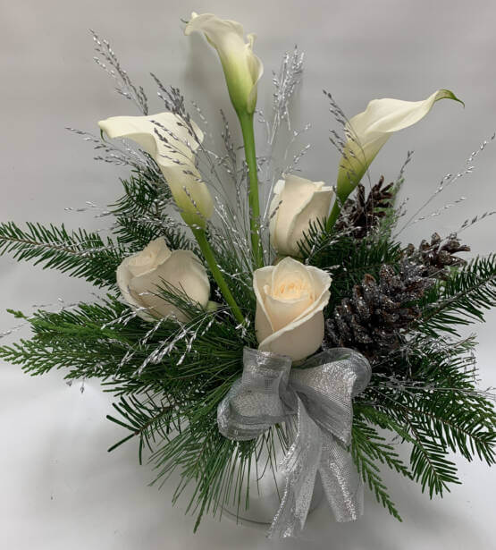 An image of a white green and silver Christmas arrangement
