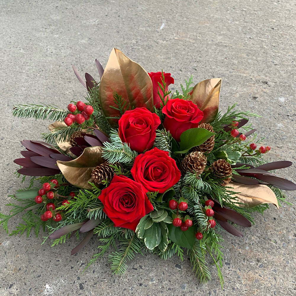 An image of a gold green and red Christmas arrangement