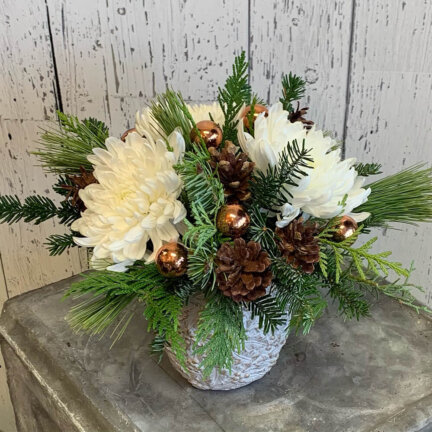 an image of a white gold and green Christmas arrangement