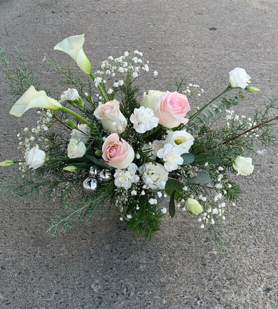 an image of a white and pink Christmas arrangement