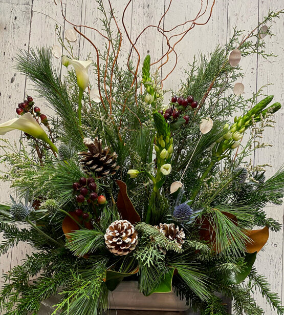 An image of a green Christmas floral arrangement
