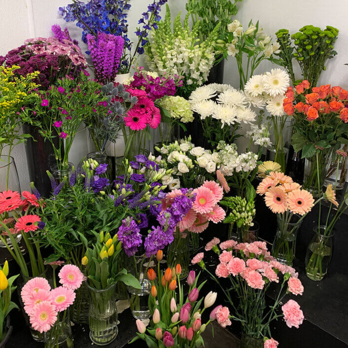 An image of a cluster of different flowers in a cooler