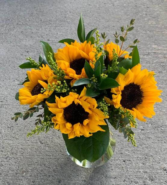 an image of sunflowers in a glass vase