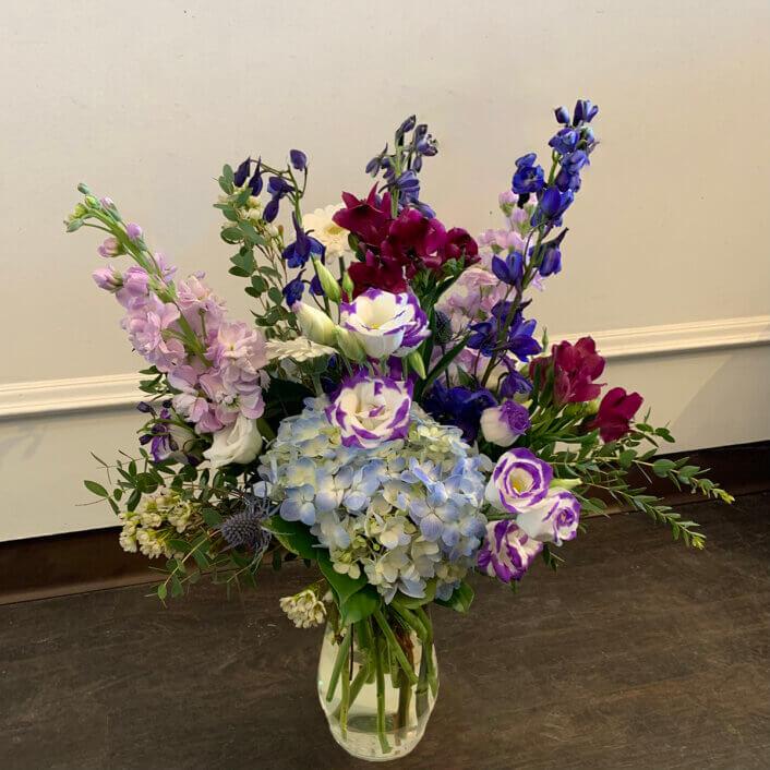 a purple blu and pink flower arrangement