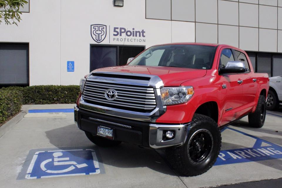 Red Toyota Tundra truck protected with Ceramic Pro Sport paint protection.