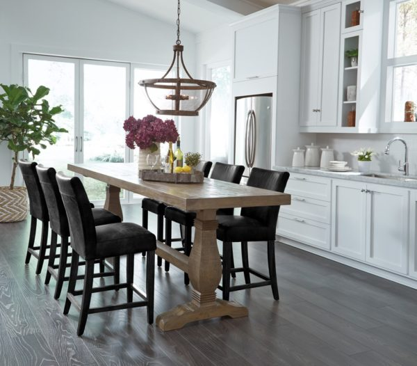 Long counter height dining table in room