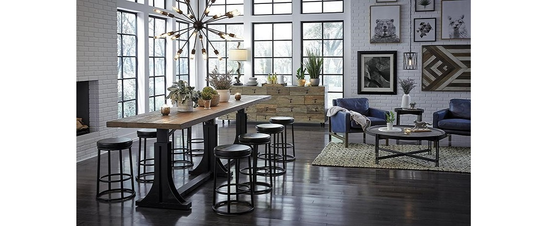wood and iron long gathering table in dining room setting
