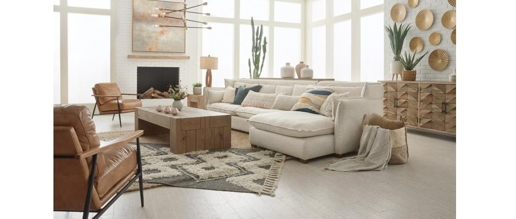 white sectional and leather club chairs in living room setting