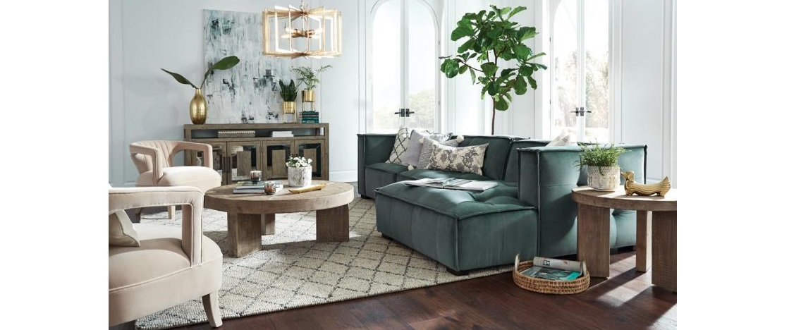 blue sectional and accent chairs in living room setting
