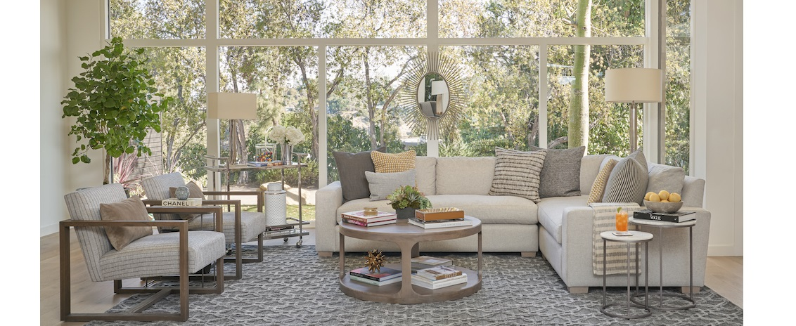 white sectional and striped accent chairs in living room setting