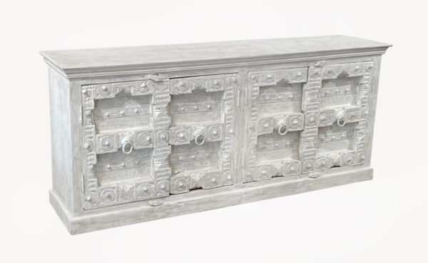 White carved sideboard cabinet with intricate door design